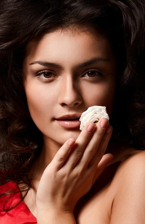 Portrait of young beautiful woman with white rose Stock Photo - 8204075