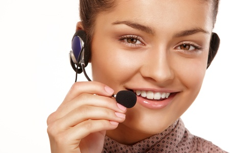 Closeup portrait of young woman talking via headset photo