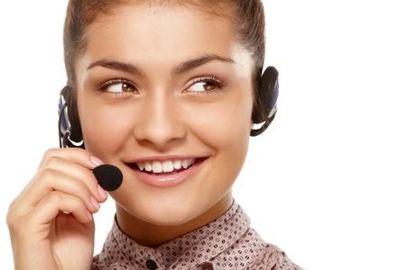 sexy secretary: Retrato de detalle de joven hablando a trav�s de auriculares Foto de archivo