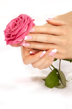 10 fingers: Beautiful manicure nails with a rose Stock Photo