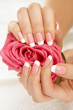 hand towel: Beautiful manicure nails with a rose Stock Photo