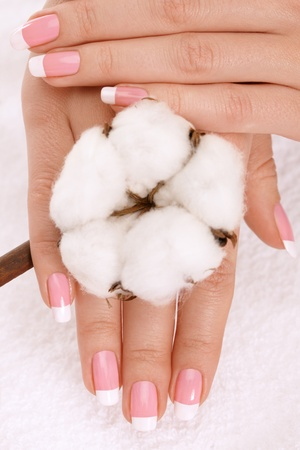 Nicely manicured hands with cotton crop over a towel Stock Photo - 8663855