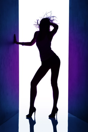 Silhouette of  dancing girl between black curtains