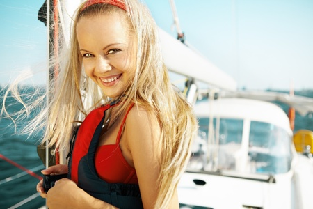Attractive girl sailing on a yacht on summer day Stock Photo - 8962124