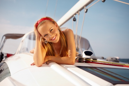 yachts: Attractive girl sailing on a yacht on summer day