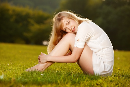 Portrait of young girl enjoying summer on a grass Stock Photo - 9723672