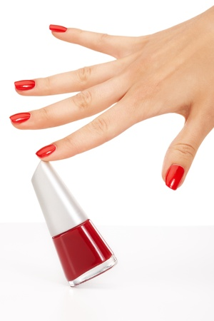 Closeup image of red manicure on top of towel