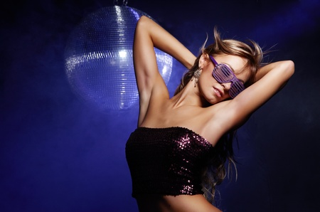 Portrait of dancing girl on disco party photo