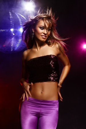 sexy girl posing: Portrait of dancing girl on disco party Stock Photo