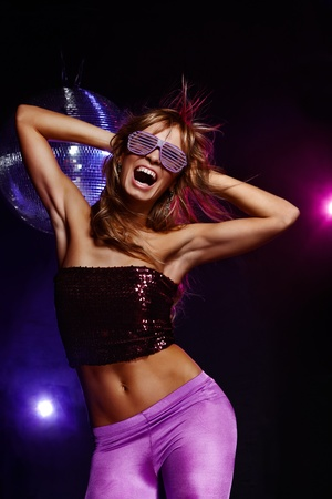 girl party: Portrait of dancing girl on disco party Stock Photo