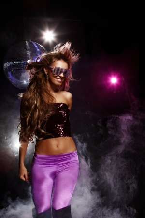 Portrait of dancing girl on disco party Stock Photo - 12296075