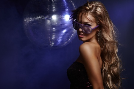 Portrait of dancing girl on disco party Imagens