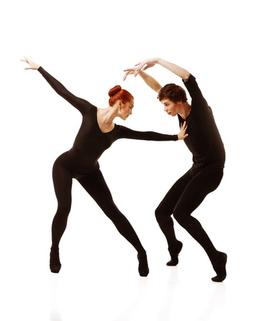 Couple of ballet dancers posing over isolated white background Stock Photo - 12631511