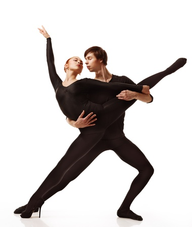 Couple of ballet dancers posing over isolated white background Stock Photo - 13090261