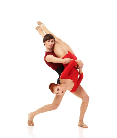 Couple of ballet dancers posing over isolated white background photo