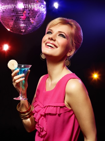 Happy beautiful girl with a drink in nightclub Stock Photo - 13288682