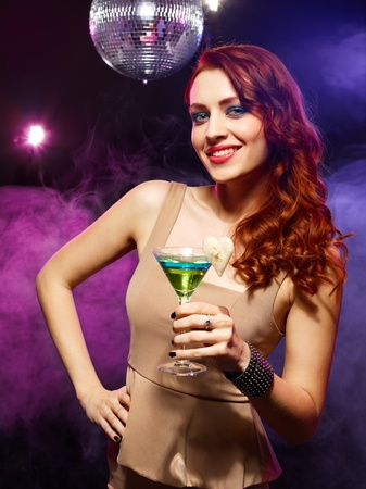 Happy beautiful girl with a drink in nightclub Stock Photo - 13288694
