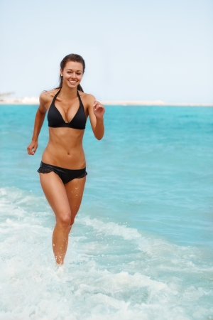 Young attractive woman jogging on the beach Stock Photo - 14449533