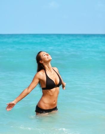 Pretty girl enjoying sun in the ocean Stock Photo - 14449534