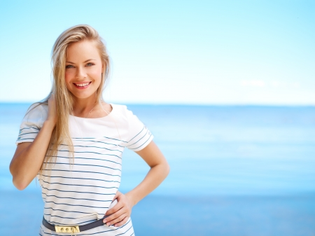 Young attractive woman near the ocean on a summer day Stock Photo - 14655222