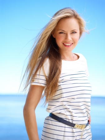 Young attractive woman near the ocean on a summer day Stock Photo - 14655220