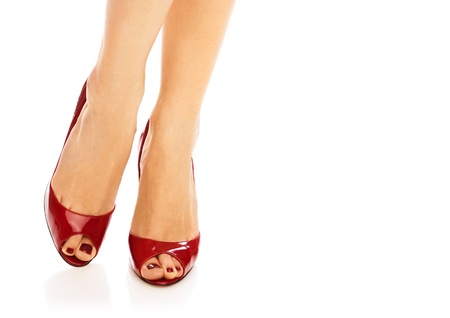 foot fetish: Female legs in red peep toes over isolated white background