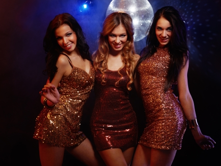 Portrait of dancing girls on disco party photo
