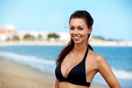 blue bikini: Pretty girl enjoying sun in the ocean Stock Photo