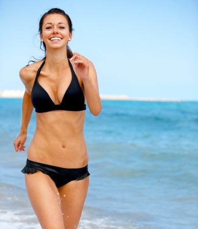 Young attractive woman jogging on the beach Stock Photo - 18381880