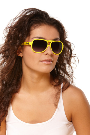 Fashionable portrait of young beautiful girl in sunglasses photo
