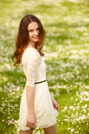 Portrait of attractive young girl on a sunny summer day photo