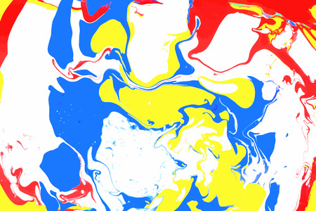 Abstract ink background. Marble style. White red yellow blue ink in water