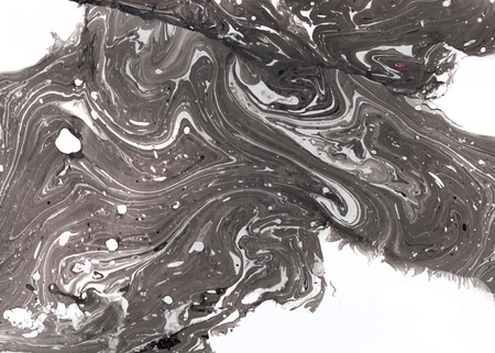 Abstract ink background. Marble style. Black and white ink in water