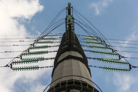High-voltage electricity pylon with insulators Stock Photo
