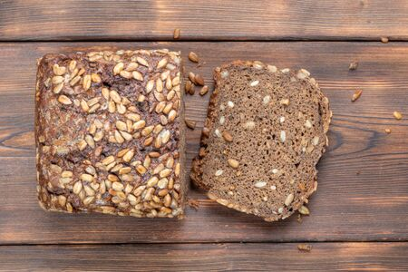 Brown Homemade Bread on wooden background Stock Photo