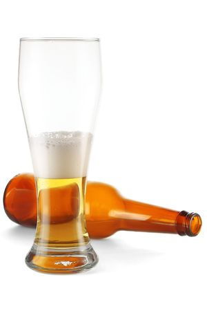 Glass with beer and lying bottle photo