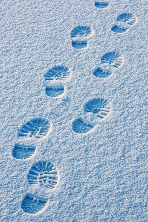 Footprints on snow surface photo