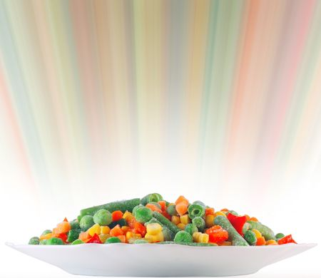 Frozen vegetables with blurry abstract background photo