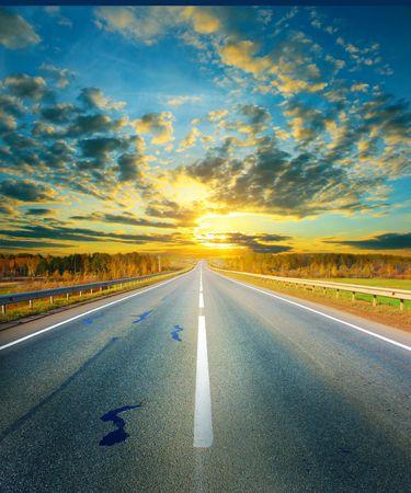 asphalt road: Sunset above asphalt road