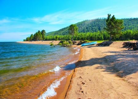 Wild sand beach on Baikal lake photo