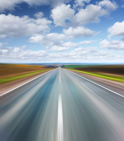 Blurry asphalt road with blue sky and clouds Stock Photo - 5776976