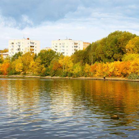 Urban pond with autumn trees photo