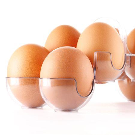 Yellow eggs in plastic protective case photo