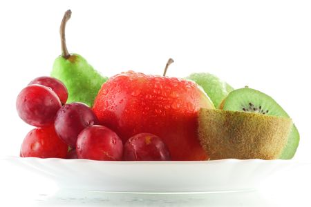 Wet fruits on plate photo