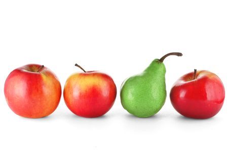different shapes: Red apples and green pear Stock Photo