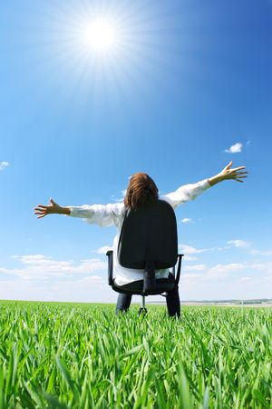 Woman on chair in green field Stock Photo - 5777407