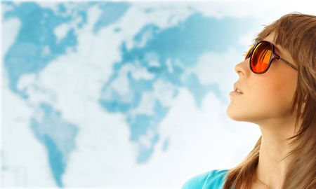 Young woman in red glasses near world map photo
