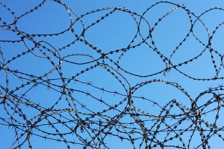 frame less: Barbed wire over blue sky