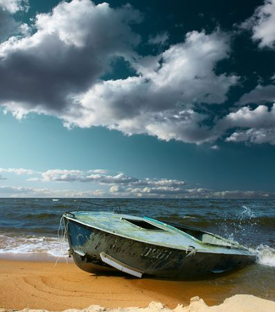 Boat on seaside with strong wind and storm clouds photo