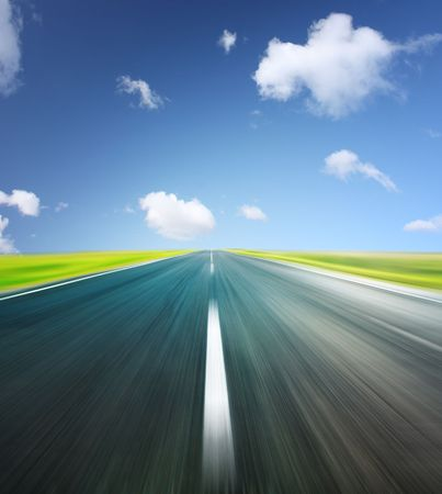 Blurry asphalt road and clear blue sky with clouds Stock Photo - 5964611
